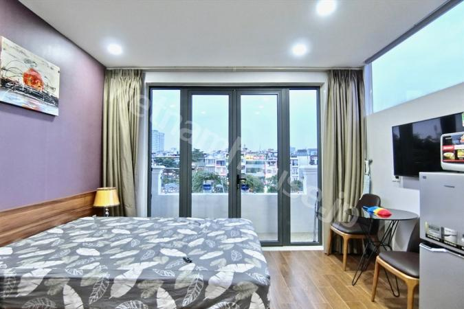 Affordable top floor serviced apartment near Nhieu Loc canal